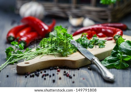 Fresh chopped parsley and red pepper - stock photo