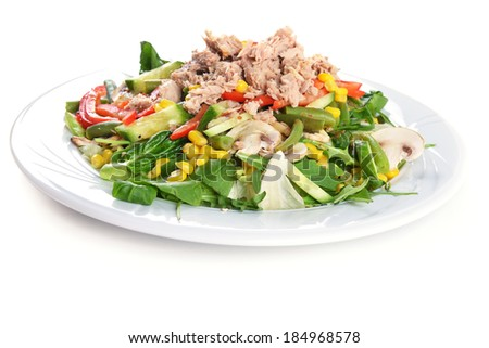 fresh chopped tuna salad with spinach on  white plate - stock photo