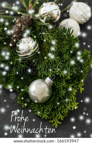 Fresh christmas decoration with christmas baubles