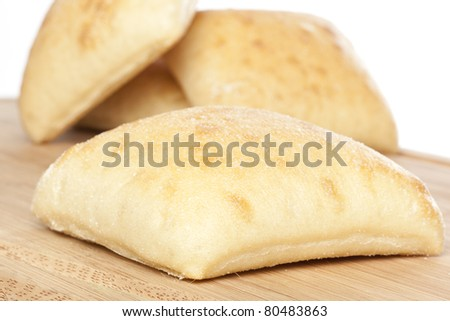 Fresh ciabatta bread against a white background - stock photo