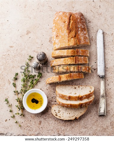 Fresh ciabatta with olive oil and thyme - stock photo