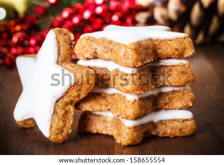 fresh cinnamon star shaped cookies with frosting - stock photo