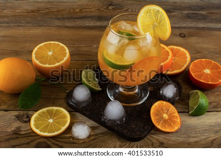 Fresh citrus drink on wooden background.  Fruit cocktail. Fruit drink. Fruit lemonade. Summer drink Citrus lemonade - stock photo