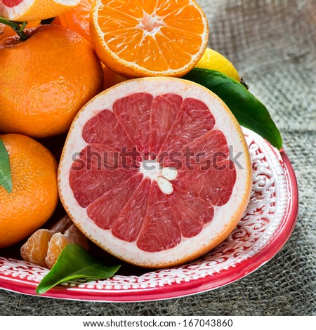 Fresh citrus fruits on rustic background, closeup - stock photo