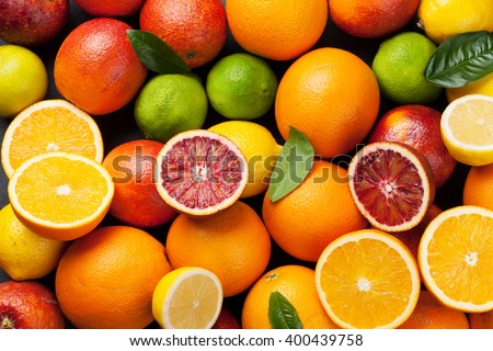 Fresh citruses. Oranges, lemons and limes. Top view - stock photo