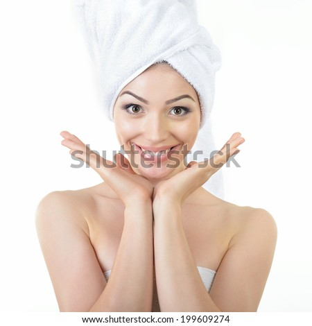 Fresh clean beautiful smiling woman wrapped in bath towels. Health, treatment, care and cosmetology concept - stock photo
