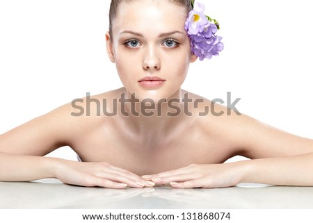 Fresh clear healthy skin on the face of beautiful woman over white background - stock photo