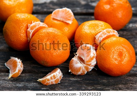 Fresh Close up Tangerines on old wooden table