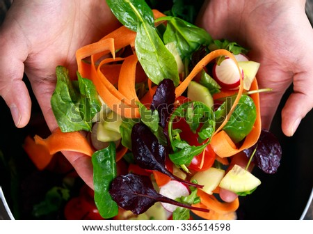 Fresh Close up Vegetable, Vegan salad in man hand. healthy food. - stock photo
