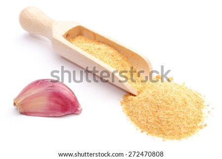 Fresh clove of garlic and heap of loose garlic on wooden spoon. Isolated on white background - stock photo