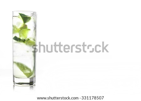Fresh cocktail with lime slices isolated on white background