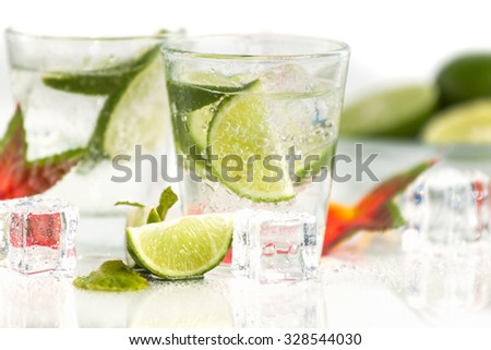 Fresh cocktail with soda, lime Isolated on white background. - stock photo