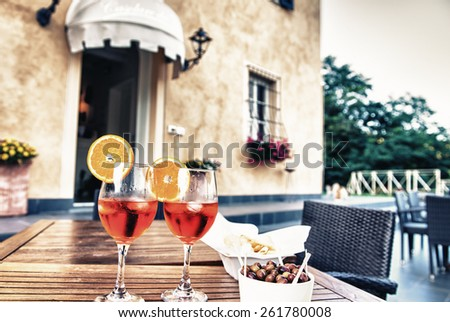 Fresh cocktails and snacks outdoor in summer season. - stock photo