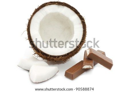 Fresh coconut and chocolate on white background - stock photo