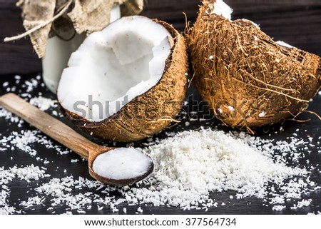Fresh coconut and coconut oil for massage or cooking - stock photo