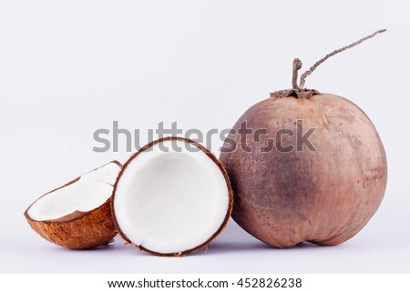 fresh coconut half clipping path for coconut milk and brown coconut shell and ripe coconut  on white background healthy fruit food isolated  - stock photo
