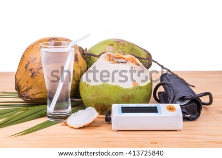 Fresh coconut juice helps to lower blood pressure, hypertension, blood cholesterol and reduce risk of heart attack - stock photo