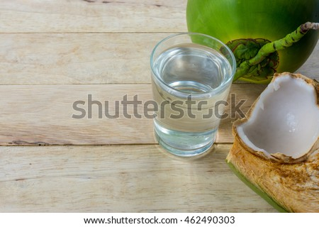Fresh Coconut Water Drink on wooden  background