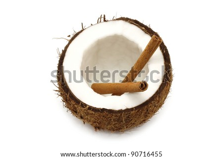 Fresh coconut with cinnamon on white background - stock photo