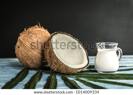 fresh coconuts on old wooden table.