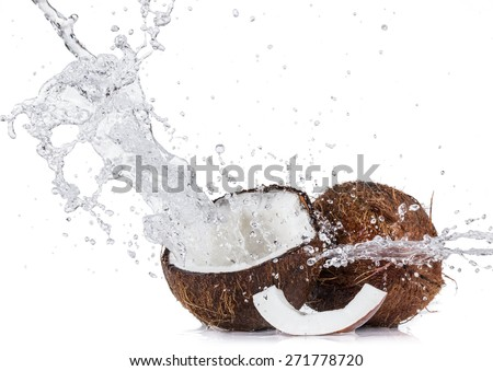 Fresh coconuts with water splash isolated on white