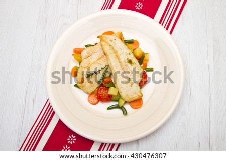 fresh cod on bed of mixed vegetables