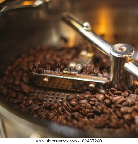 Fresh Coffee Beans - Fresh 100% Arabica coffee beans spinning in a cooler. - stock photo