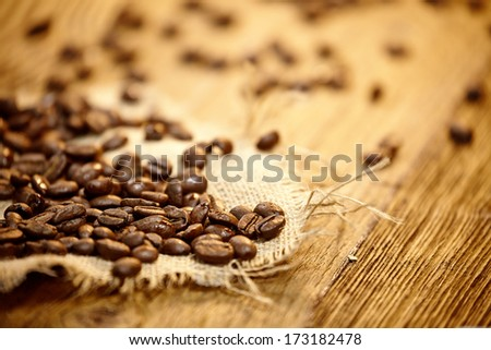 Fresh coffee beans on wood background, Macro close-up for design work  - stock photo