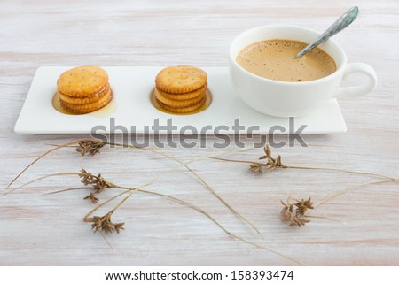 Fresh coffee in cup with cookie and honey - stock photo