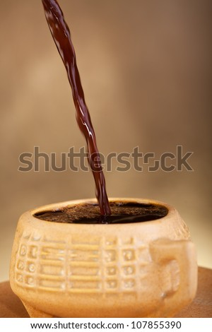 Fresh coffee pouring into cup - stock photo