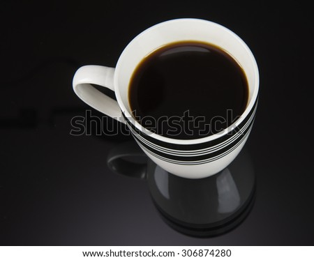 Fresh Coffee pouring into fancy cup on table top - stock photo