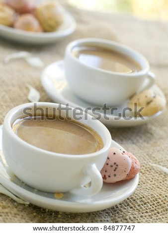 Fresh coffee with milk in cup  with cookie close up. Selective focus - stock photo