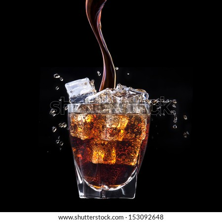 Fresh cola drink background with ice and splash on a black - stock photo