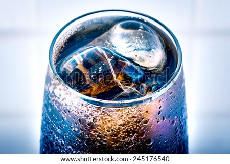 Fresh cola drink with ice - stock photo