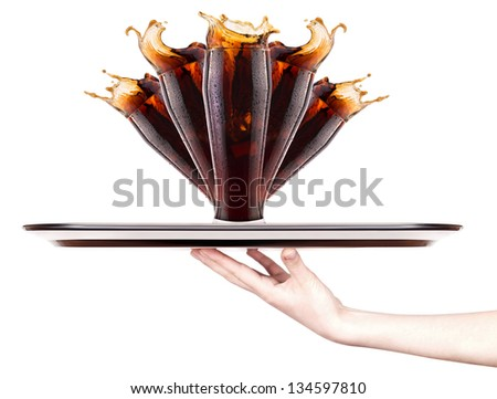 Fresh cola  with splash on a tray with hand isolated on a white - stock photo