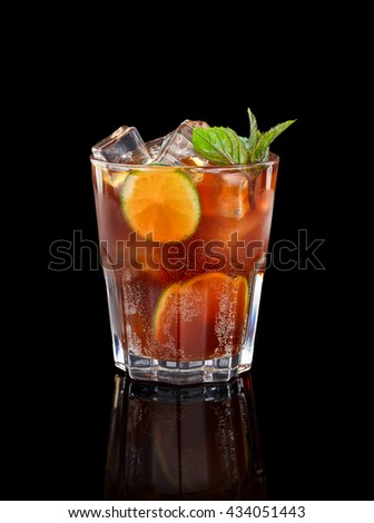 Fresh cold alcohol drink over black background