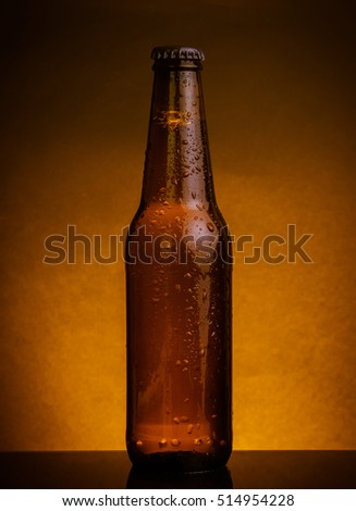 fresh cold beer ale bottle with drops and stopper on warm background