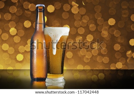 Fresh cold beer on beautiful bokeh background - stock photo