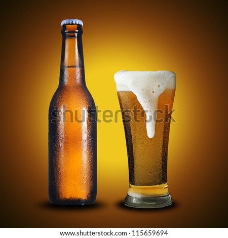 Fresh cold bottle and glass of beer on yellow background - stock photo