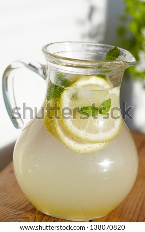 Fresh cold ginger lemonade with ice - stock photo