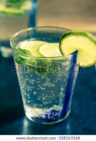 Fresh cold water with lime and mint. Toned picture