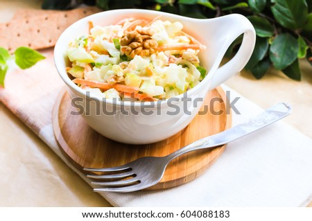 ... apples and pears with walnuts and yogurt dressing in a bowl, selective