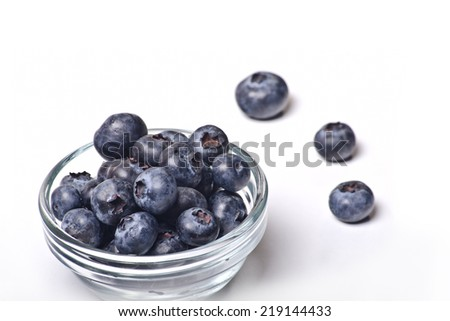 fresh colored forest berries on white background