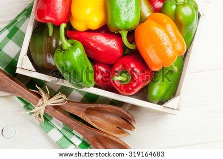 Fresh colorful bell pepper cooking on wooden table. Top view