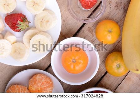 Fresh colorful fruits composition mandarin, bananas and orange - stock photo