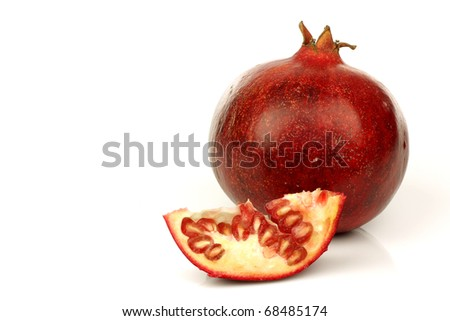fresh colorful pomegranate and a slice on a white background