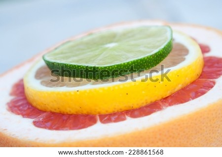 Fresh colorful tropical fruit slices - lemon, lime, red grapefruit
