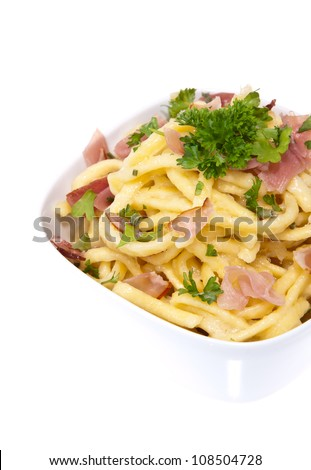 Fresh cooked Cheese Spaetzle isolated on white background - stock photo