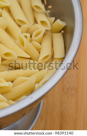 Fresh cooked pasta in a colander
