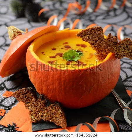 Fresh cooked pumpkin soup on Halloween